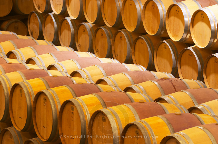 The barrel aging cellar with rows of barriques Chateau Paloumey Haut-Medoc Ludon Medoc Bordeaux Gironde Aquitaine France