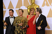 Sam Rockwell, Frances McDormand, Allison Janney and Gary Oldman pose backstage with the Oscar&reg; during the live ABC Telecast of The 90th Oscars&reg; at the Dolby&reg; Theatre in Hollywood, CA on Sunday, March 4, 2018.<br /> *Editorial Use Only*<br /> CAP/PLF/AMPAS<br /> Supplied by Capital Pictures