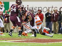 Blacksburg, VA - September 30, 2017: Virginia Tech Hokies running back Deshawn McClease (33) is tackled by a Clemson Tigers defender during the game between Clemson and VA Tech at  Lane Stadium in Blacksburg, VA.   (Photo by Elliott Brown/Media Images International)