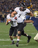 Cincinnati offensive tackle Sean Hooey (77) blocks for DJ Woods (3).  Cincinnati Bearcats defeated the Pitt Panthers 26-23 at Heinz Field in Pittsburgh, Pennsylvania on November 5, 2011.