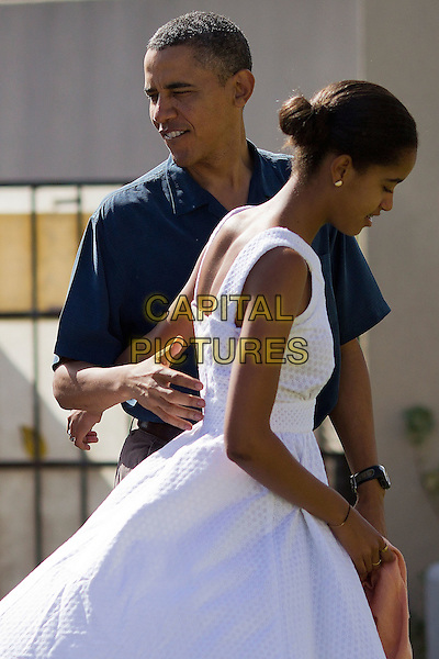 United States President Barack Obama and his daughter Malia Obama prepare to enter the Marine Corps Base Hawaii Chapel to attend Christmas services in Kaneohe, Hawaii, Sunday, December 25, 2011.  Obama is spending the Christmas holiday in his native Hawaii with his family. .CAP/ADM/CNP/Pool/KN.©Kent Nishimura/Pool/CNP/AdMedia/CapitalPictures.