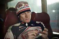 Paris-Roubaix 2012 ..Andre Greipel in the teambus at Compiegne prepping his fingers