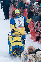 Melissa Owens team leaves the start line during the restart day of Iditarod 2009 in Willow, Alaska