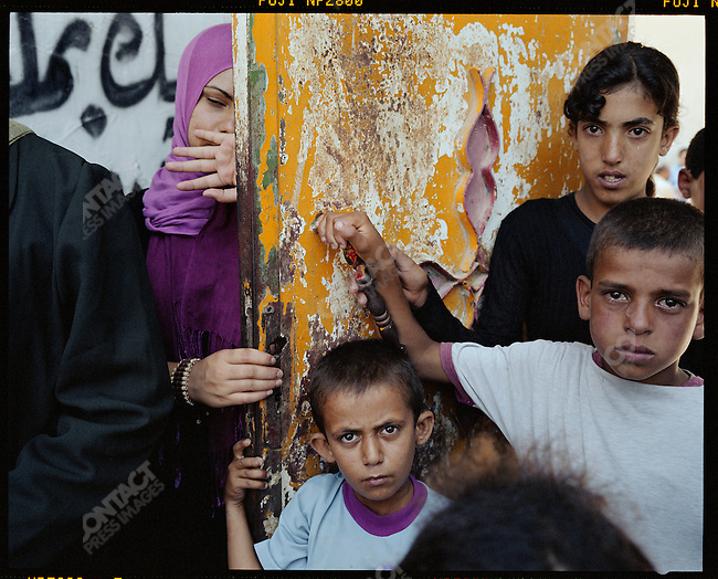 """Young Palestinians at a funeral of a """"martyr."""" Beit Hanoun Refugee Camp, Gaza, July 2004"""