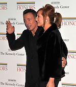 Washington, DC - December 5, 2009 -- Bruce Springsteen, one of the 2009 Kennedy Center honorees, left, waves to photographers as he  his wife, Patti Scialfa Springsteen, left, arrives for the formal Artist's Dinner at the United States Department of State in Washington, D.C. on Saturday, December 5, 2009..Credit: Ron Sachs / CNP.(RESTRICTION: NO New York or New Jersey Newspapers or newspapers within a 75 mile radius of New York City)