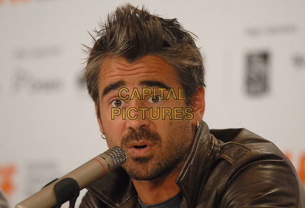 "COLIN FARRELL .""Ondine"" Press Conference held at Sutton Place Hotel during the 2009 Toronto International Film Festival,Toronto, Ontario, Canada,.15th September 2009..portrait headshot brown leather jacket grey gray t-shirt spiky hair beard facial hair silver hoop earrings microphone speaking .CAP/ADM/BPC.©Brent Perniac/Admedia/Capital Pictures"