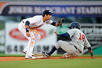 Lakeland Flying Tigers shortstop Eduardo Suarez #13 takes a throw as  Dionis Hinojosa #18 slides in during a game against the Brevard County Manatees on April 10, 2013 at Joker Marchant Stadium in Lakeland, Florida.  Brevard County defeated Lakeland 7-6.  (Mike Janes/Four Seam Images)