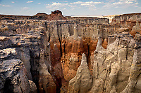 Eroded sandstone rock formations make up the landscape at Coalmine Canyon in Northern Arizona