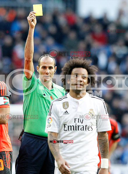 Spanish referee Alfonso Alvarez Izquierdo show yellow card to Real Madrid's Marcelo Vieira during La Liga match.January 31,2015. (ALTERPHOTOS/Acero) /NortePhoto<br />