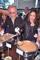 MIAMI, FL - NOVEMBER 22: Gloria Estefan (R) and Emilio Estefan participate in 5th Annual Thanksgiving Feed A Friend at Bongos Cuban Cafe on November 22, 2012 in Miami, Florida. © MPI10/MediaPunch Inc /NortePhoto