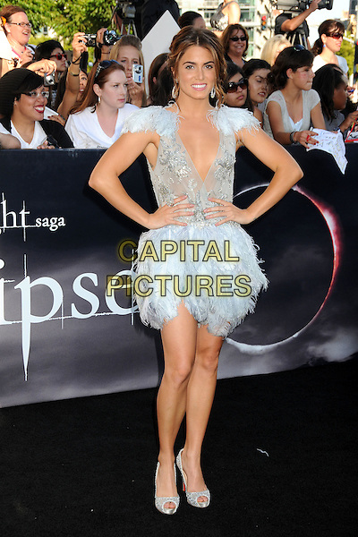 "NIKKI REED .""The Twilight Saga: Eclipse"" Los Angeles Premiere at the 2010 Los Angeles Film Festival held at Nokia Theatre LA Live, Los Angeles, California, USA, 24th June 2010..full length blue pale dress feathers feather low cut mesh shoulders skirt plunging neckline hands on hips silver peep toe shoes christian louboutin beaded .CAP/ADM/BP.©Byron Purvis/AdMedia/Capital Pictures."