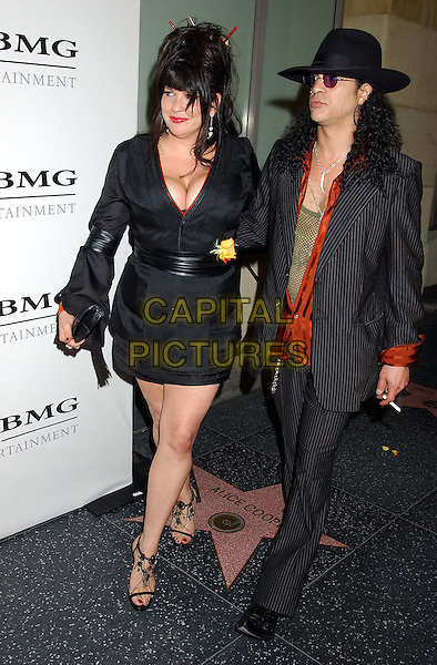 VELVET REVOLVER - SLASH & PERLA FERRAR.Sony BMG Grammy Party 2005 held at the Roosevelt Hotel, Los Angeles, California.February 12th, 2005.Photo Credit: Laura Farr/AdMedia.full length arm over shoulder married husband wife hat striped top cigarette black skirt top pinstripe suit cleavage.www.capitalpictures.com.sales@capitalpictures.com.© Capital Pictures.