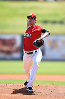 Birmingham Barons pitcher Myles Jaye (14) delivers a pitch during a game against the Tennessee Smokies on April 21, 2014 at Regions Field in Birmingham, Alabama.  Tennessee defeated Birmingham 10-5.  (Mike Janes/Four Seam Images)