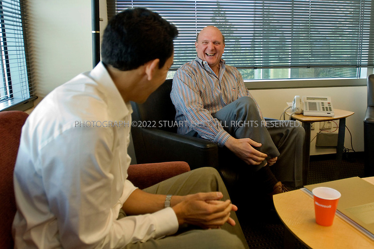 1/23/2006--Redmond, WA, USA..9:54am: Steve Ballmer (right), CEO of Microsoft, starts a meeting by sharing a joke with Yusuf Mehdi, senior vice president & chief Advertising Strategist of Microsoft. The meeting was held to talk about Microsoft?s strategy for the online advertising market. .Photograph ©2007 Stuart Isett.All rights reserved