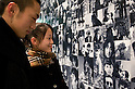 SAITAMA - DEC. 5: Two Japanese high-school pupils look at a photographic mural wall at the John Lennon Museum, Saitama, Tokyo.  (Photo by Alfie Goodrich/Nippon News)