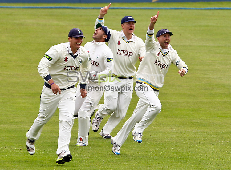 PICTURE BY ALEX WHITEHEAD/SWPIX.COM - Cricket - LV County Championship Division 1 - Yorkshire vs Nottinghamshire - Day 1 - North Marine Road, Scarborough, England - 05/06/13 - (From left) Yorkshire's Alex Lees, Andrew Hodd (catcher), Gary Ballance and Adam Lyth celebrate the wicket of Nottinghamshire's Alex Hales (bowled by Ryan Sidebottom).