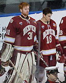 Evan Cowley (DU - 31), Emil Romig (DU - 18) - The Boston College Eagles defeated the University of Denver Pioneers 6-2 in their NCAA Northeast Regional semi-final on Saturday, March 29, 2014, at the DCU Center in Worcester, Massachusetts.