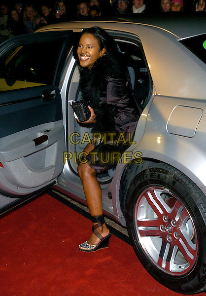 "KELLE BRYAN.Arrives at ""An Audience With Take That"".at The London Television Studios,.London, England, December 2nd 2006..full length getting out of car wedges shoes kelly.CAP/CAN.©Can Nguyen/Capital Pictures"