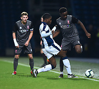 Lincoln City U18's Jordan Adebayo-Smith is tackled by West Bromwich Albion U18's Nathan Ferguson<br /> <br /> Photographer Andrew Vaughan/CameraSport<br /> <br /> FA Youth Cup Round Three - West Bromwich Albion U18 v Lincoln City U18 - Tuesday 11th December 2018 - The Hawthorns - West Bromwich<br />  <br /> World Copyright &copy; 2018 CameraSport. All rights reserved. 43 Linden Ave. Countesthorpe. Leicester. England. LE8 5PG - Tel: +44 (0) 116 277 4147 - admin@camerasport.com - www.camerasport.com