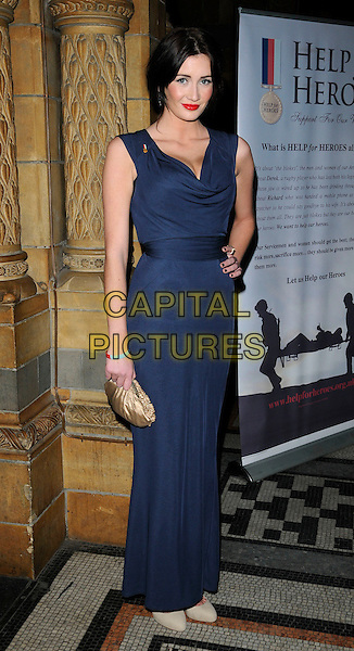 PETA TODD.At the Victory Ball, Natural History Museum, London, England, UK,  November 25th 2010..full length blue long maxi dress hand on hip gold clutch bag cream shoes .CAP/CAN.©Can Nguyen/Capital Pictures.