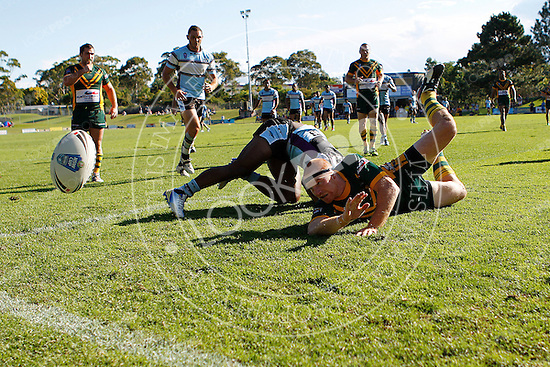 Jay Florimo of the Wyong Roos saves a try by the Cronulla Sharks during Round 5 of the 2013 NSW Cup at Morrie Breen Oval on April 7, 2013 in Wyong, Australia. (Photo by Paul Barkley/LookPro)