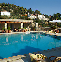 The swimming pool terrace is situated in the garden below the villa