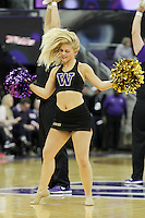SEATTLE, WA - DECEMBER 18: Washington cheerleader Hannah Alonzo entertained fans during a timeout against Savannah State.  Washington won 87-36 over Savannah State at Alaska Airlines Arena in Seattle, WA.