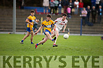 St Senans Barry O'Mahoney takes the ball out of danger as Paul McMahon of St Pats Blennerville keeps an eye on him, in the 3rd round of the Junior Premier Championship in Mountcoal on Sunday.