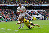 Dan Norton of England is tackled by Con Foley of Australia during Day Two of the iRB Marriott London Sevens at Twickenham on Sunday 11th May 2014 (Photo by Rob Munro)