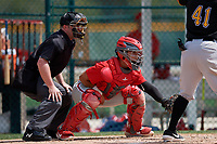 Philadelphia Phillies Rafael Marchan (6) and umpire John Mang during a minor league Spring Training game against the Pittsburgh Pirates on March 13, 2019 at Pirate City in Bradenton, Florida.  (Mike Janes/Four Seam Images)