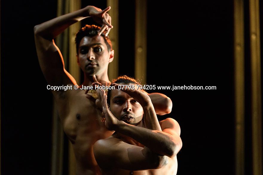 Shobana Jeyasingh presents the London premiere of MATERIAL MEN REDUX, at The Place. Dancers are: Shailesh Bahoran (purple trousers) and Sooraj Subramaniam (grey trousers).