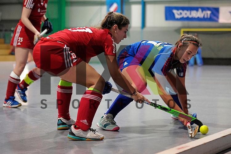 GER - Mannheim, Germany, December 19: During the 1. Bundesliga Sued Damen indoor hockey match between Mannheimer HC (blue) and Nuernberger HTC (red) on December 19, 2015 at Irma-Roechling-Halle in Mannheim, Germany.  Just #27 of Nuernberger HTC, Julia Meffert #97 of Mannheimer HC<br /> <br /> Foto &copy; PIX-Sportfotos *** Foto ist honorarpflichtig! *** Auf Anfrage in hoeherer Qualitaet/Aufloesung. Belegexemplar erbeten. Veroeffentlichung ausschliesslich fuer journalistisch-publizistische Zwecke. For editorial use only.