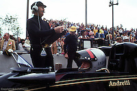 LONG BEACH, CA - APRIL 3: Colin Chapman (standing) oversees work on the Lotus 78 R3/Ford Cosworth DFV driven to victory by Mario Andretti in the 1977 United States Grand Prix West on April 3, 1977, on the temporary street course in Long Beach, California.