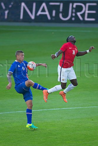 01.06.2016  Ullevaal Stadion, Oslo, Norway.  Ragnar Sigurosson of Iceland  battles with  Adama Diomande of Norway for a high ball during  the International Football Friendly  match between Norway versus Iceland at Ullevaal Stadion in Oslo, Norway.