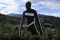 """MEDELLÍN - COLOMBIA, 07-06-2014. Una silueta con los nombres de las personas desaparecidas en """"La Escombrera"""", en la Comuna 13 de Medellín, durante una vigilia contra las desapariciones forzadas. En 2002, Medellín fue sacudido por la violencia después de la decisión del Gobierno de recuperar un sector de la ciudad disputada por los paramilitares de derecha y las milicias de izquierda. Según los familiares de las víctimas, en la operación ordenada el 16 de octubre de 2002 por el presidente Álvaro Uribe, decenas de personas murieron, más de 100 personas resultaron heridas, 98 personas desaparecieron y más de 200 familias fueron desplazadas./  A silhouette with the names of missing persons in """"The Dump"""" in Comuna 13 in Medellín, during a vigil against forced disappearances. In 2002, Medellín was rocked by violence following the government's decision to recover a part of the city disputed by right-wing paramilitaries and leftist militias. According to relatives of the victims, the orderly operation on October 16, 2002 by President Alvaro Uribe, dozens of people were killed, over 100 people were injured, 98 people missing and more than 200 families were displaced. Photo: VizzorImage/Luis Rios/STR"""