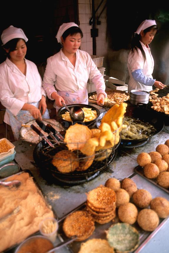 Women street vendors cooking in Kumming China