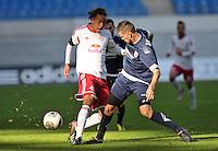 Fußball 3. Liga 2013/14 - Rasenballsport Leipzig (RB) gegen SSV Jahn Regensburg am 19.10.2013 in Leipzig (Sachsen). <br /> IM BILD: Yussuf Poulsen (RB) am Ball gegen Azur Velagic (SSV) <br /> Foto: Christian Nitsche / aif