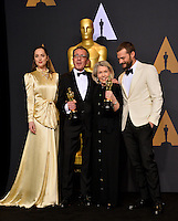 Dakota Johnson, David Wasco, Sandy Reynolds-Wasco &amp; Jamie Dornan in the photo room at the 89th Annual Academy Awards at Dolby Theatre, Los Angeles, USA 26 February  2017<br /> Picture: Paul Smith/Featureflash/SilverHub 0208 004 5359 sales@silverhubmedia.com