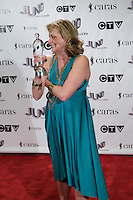 Jane Bunnett, winner of the 2009 Juno for Contemporary Jazz album of the Year, poses on the media wall, Saturday March 28th, 2009, at the Westin Bayshore Hotel in Vancouver.  (Scott Alexander/pressphotointl.com)