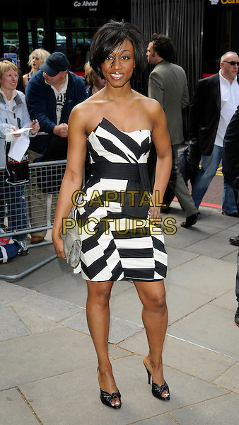 BEVERLEY KNIGHT .Outside arrivals - 54th Ivor Novello Awards, at the Grosvenor House Hotel, London, England, May 21, 2009..Full length strapless black and white sequined shiny dress open toe shoes silver clutch bag .CAP/CAN.©Can Nguyen/Capital Pictures