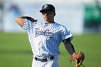 Robert Javier (18) of the Pulaski Yankees warms up in the outfield prior to the game against the Greeneville Reds at Calfee Park on June 23, 2018 in Pulaski, Virginia. The Reds defeated the Yankees 6-5.  (Brian Westerholt/Four Seam Images)