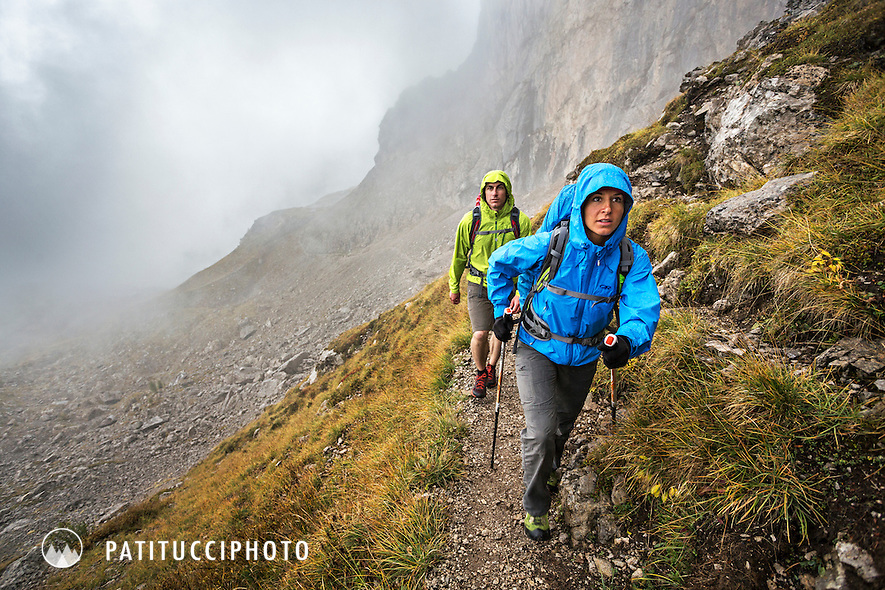 Two hikers in the rain on the Dolomites Alta Via 2