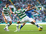 Celtic v St Johnstone...29.08.15  SPFL   Celtic Park<br /> Chris Millar tackles Emilio Izaguiree<br /> Picture by Graeme Hart.<br /> Copyright Perthshire Picture Agency<br /> Tel: 01738 623350  Mobile: 07990 594431