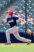 Tyler Moore #12 of the Harrisburg Senators follows through on his swing against the Richmond Flying Squirrels at The Diamond on July 22, 2011 in Richmond, Virginia.  The Squirrels defeated the Senators 5-1.   (Brian Westerholt / Four Seam Images)