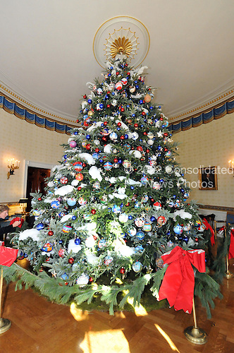 """Washington, DC - December 3, 2008 -- White House Christmas tree in the Blue Room during the media preview of the 2008 holiday decorations and tasting event on the State Floor of the White House in Washington, D.C. on Wednesday, December 3, 2008.  The theme of this years decorations is """"a Red, White, and Blue Christmas"""".  The tree is decorated with 369 hand-decorated ornaments specially designed to characterize the unique patriotic spirit of the artist's state.  Each member of the United States House and Senate was invited by first lady Laura Bush to commission an ornament.  The Official White House Christmas Tree is an 18 1/2 -foot tall Fraser fir presented to Mrs. Bush by Jesse Davis and Russell Estes of River Ridge Tree Farms in Crumpler, North Carolina..Credit: Ron Sachs / CNP"""