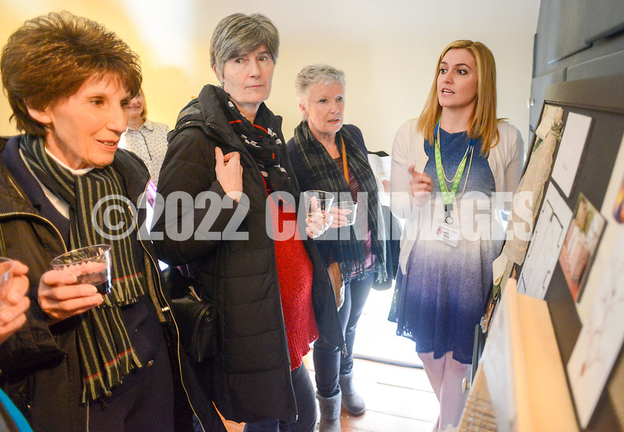 Whitney Little (right) of Lux Interiors speaks about her concepts for the room she was assigned at the Bucks County Designer House Empty House Party Sunday, February 26, 2017 in Buckingham, Pennsylvania. (Photo by William Thomas Cain)