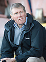 Kenny Mcaskell takes his seat in the stand before the match ...