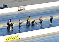 Apr. 13, 2012; Concord, NC, USA: NHRA safety safari keeps up on repairs to breaking up track during qualifying for the Four Wide Nationals at zMax Dragway. Mandatory Credit: Mark J. Rebilas-