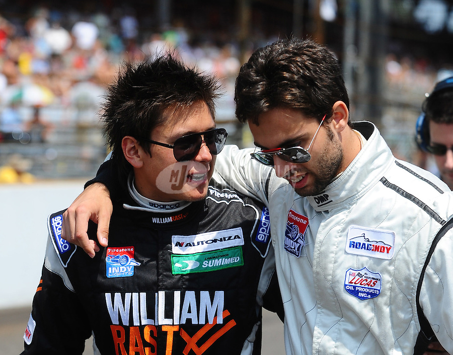 May 28, 2010; Indianapolis, IN, USA; Indy Light Series driver Sebastian Saavedra (left) with Adrian Campos Jr. during the Freedom 100 at the Indianapolis Motor Speedway. Mandatory Credit: Mark J. Rebilas-