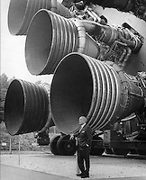 Huntsville, Alabama. USA - Date Unknow, circa 1969- <br /> <br /> A pioneer of America's space program, Dr. von Braun stands by the five F-1 engines of the Saturn V launch vehicle. This Saturn V vehicle is an actual test vehicle which has been displayed at the U.S. Space Rocket Center in Huntsville, Alabama. Designed and developed by Rocketdyne under the direction of the Marshall Space Flight Center, a cluster of five F-1 engines was mounted on the Saturn V S-IC (first) stage. The engines measured 19-feet tall by 12.5-feet at the nozzle exit and burned 15 tons of liquid oxygen and kerosene each second to produce 7,500,000 pounds of thrust. The S-IC stage is the first stage, or booster, of a 364-foot long rocket that ultimately took astronauts to the Moon.